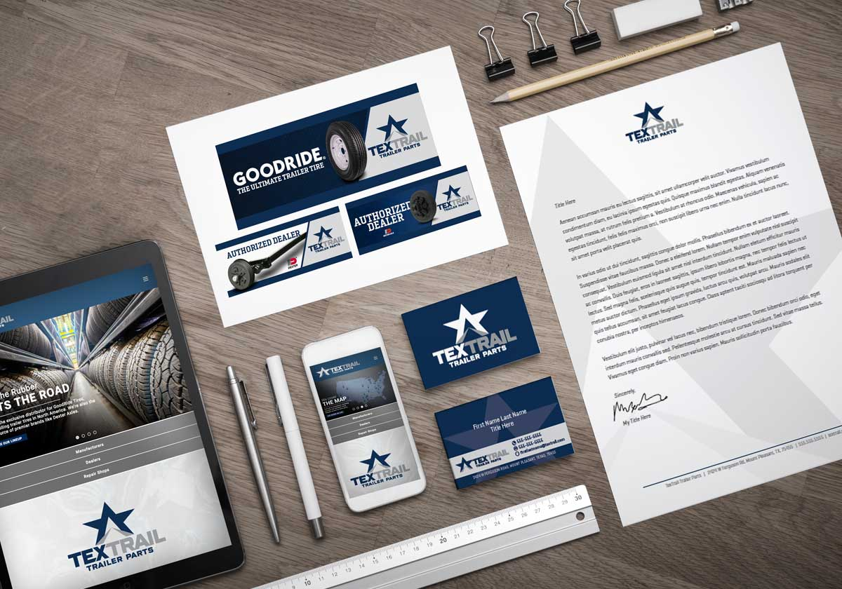 Table covered in TexTrail brand assets like advertisements, letterheads, and business cards