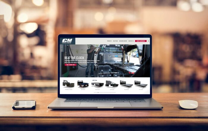 CM Truck Beds website displayed on a laptop screen