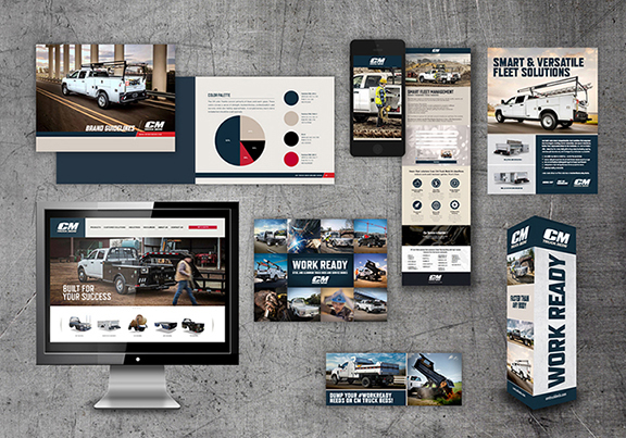 Collection of CM Truck Beds ads, magazines, and webpages on a concrete background