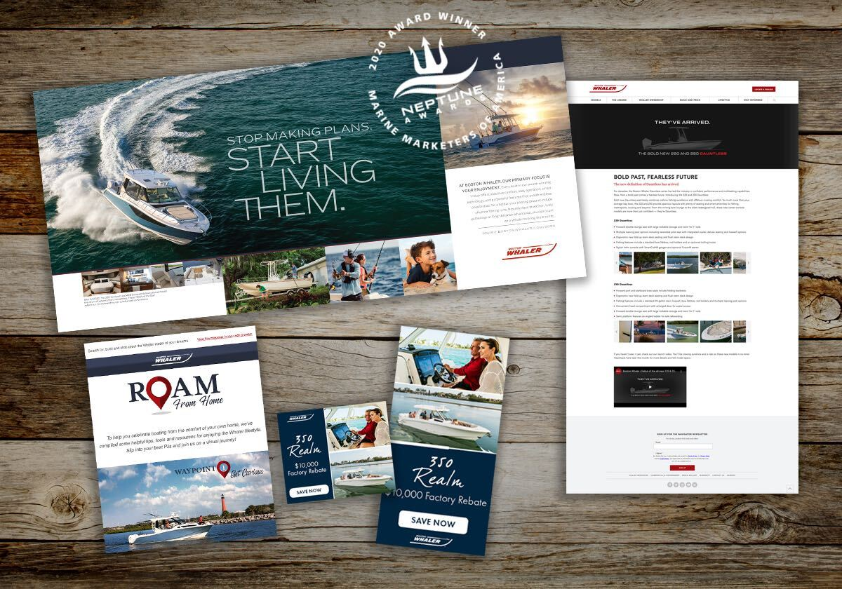 Rustic wood boards scattered with Boston Whaler brochures, coupons, magazine spreads, and website pages