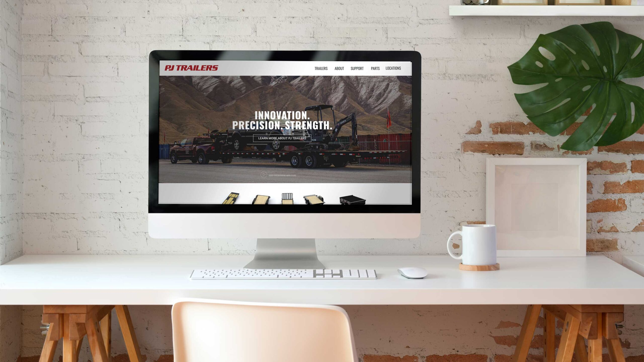 Desktop computer displaying the PJ Trailers website